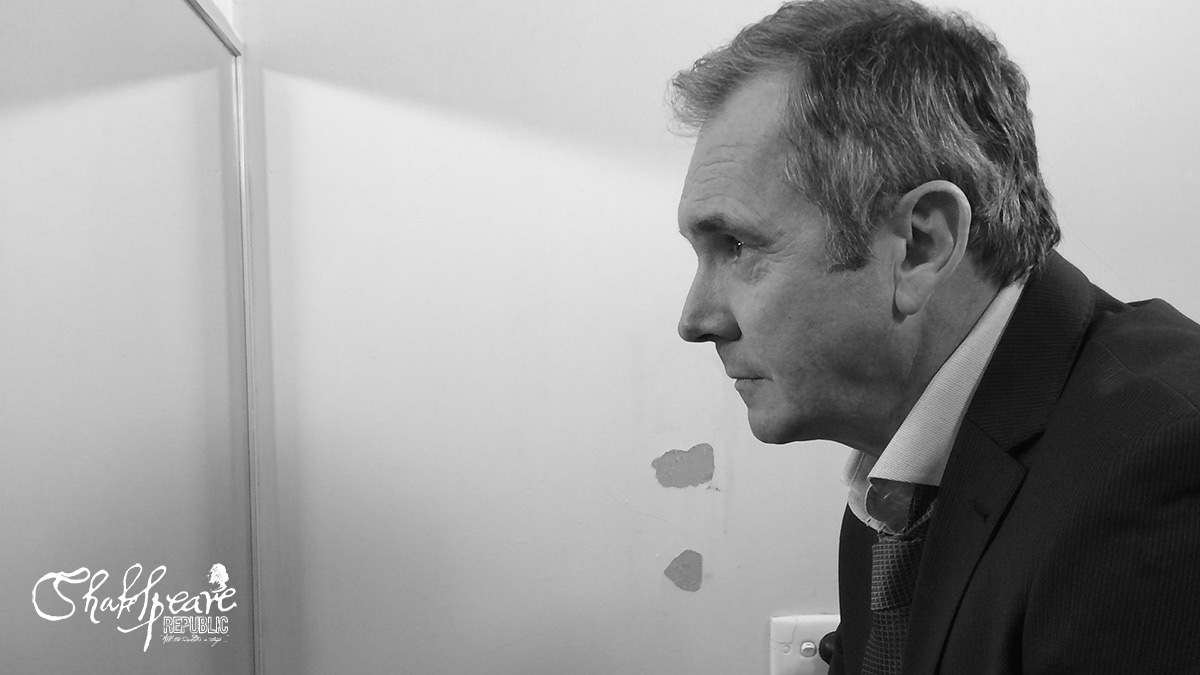 Alan Fletcher waits patiently as we maneuver the camera in a small bathroom for the first day's filming of Shakespeare Republic (Photo: Ben Steel)
