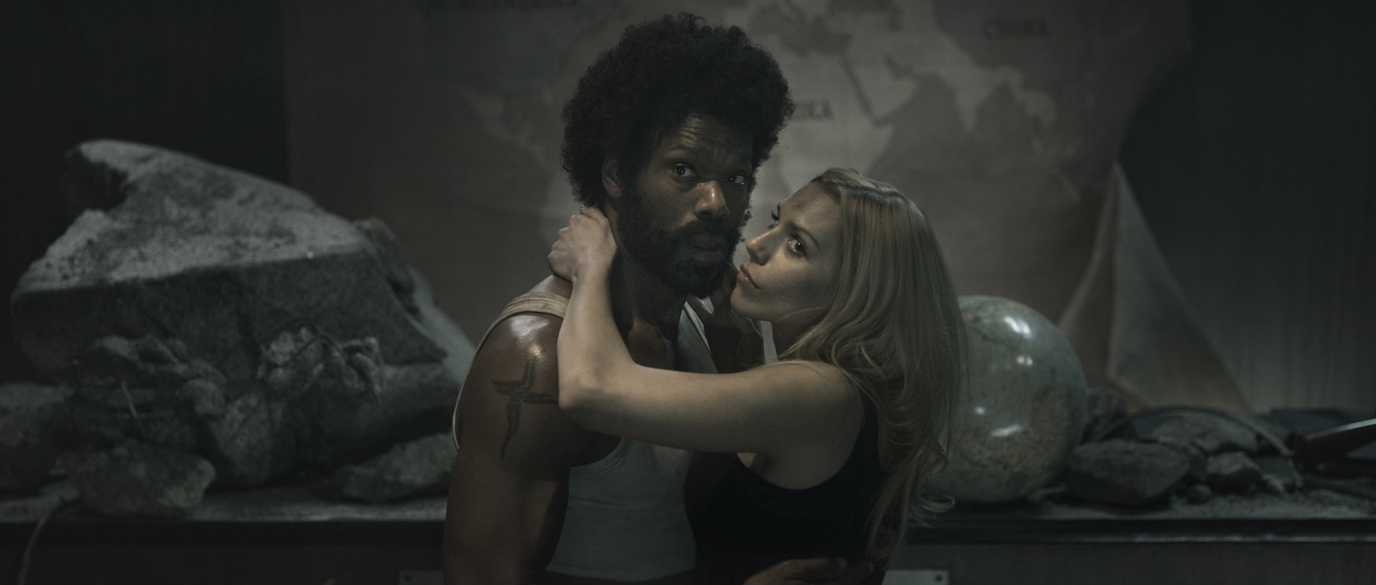 "Christopher Kirby as James Washington with  Julia Dietze as  Renate Richter in ""Iron Sky"""